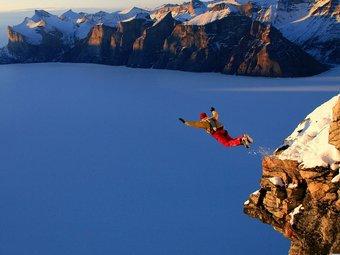A man cliff jumping.